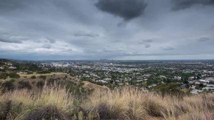 Fotobehang - Storm clouds city Los Angeles cityscape rainy weather 4K UHD timelapse