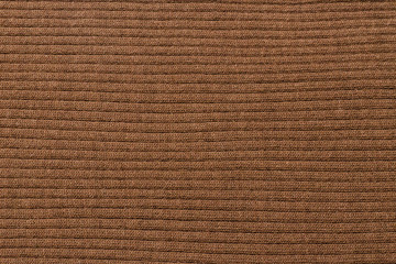 Brown ribbed texture. Knitted fabric