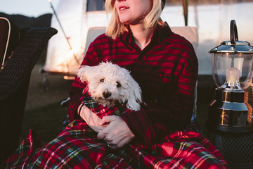 woman camping with her dog