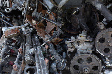 Scrap metal car parts on the floor.