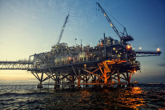 oil rig at sunset with beautiful lights