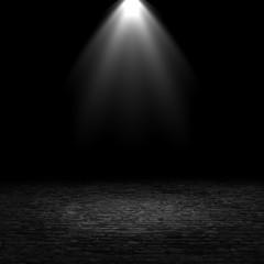 3D spotlight shining down into a grunge interior with brick floor