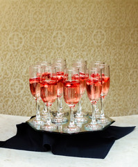 Closeup of glasses of champagne in a row on a table champagne serving champagne on a tray