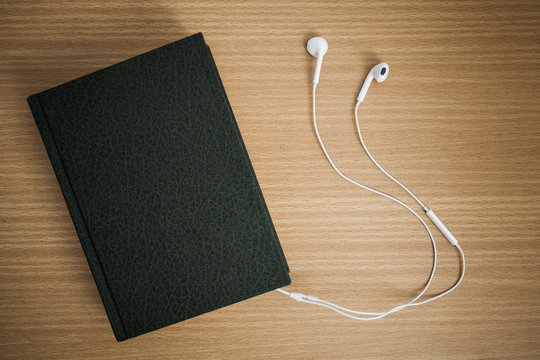 Bible connected with earphones