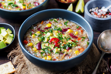 Vegetable quinoa soup stew with avocado corn beans