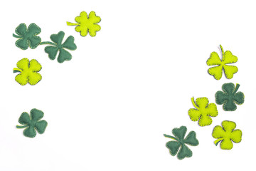 Felt leaves of clover on white background. Space for text.