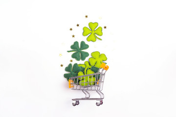 Shopping trolley with four-leaf clover on whte background. St.Patrick's day symbol.