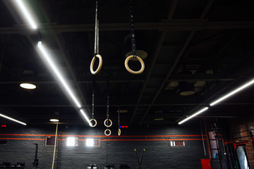 Wooden Gymnastic rings in the interior of the gym loft. Nobody.