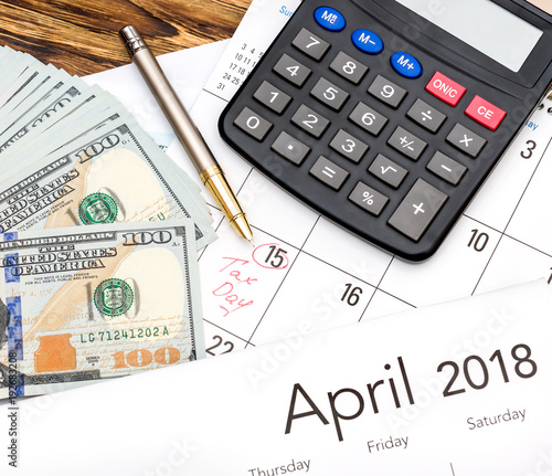 Money Calculator And Calendar On The Table Tax Time Concept