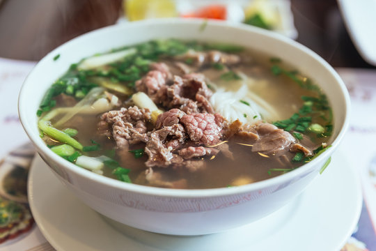 Beef Pho is a Vietnamese soup consisting of broth, rice noodles called bánh phở, a few herbs, and meat, primarily made with either beef or chicken.