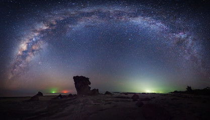 Stitched Panorama Starry night sky with milkyway galaxy. Image contain soft focus, blur and noise due to long expose and high iso. Fototapete