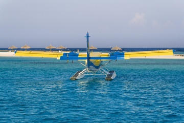 Private seaplane on the ocean lagoon.