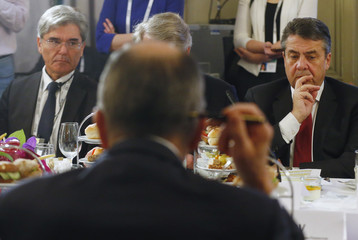 Siemens CEO Kaeser and German Foreign Minister Gabriel meet Russian Foreign Minister Lavrov at the Munich Security Conference in Munich