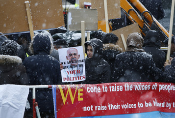 Protesters gather outside the venue of the Munich Security Conference in Munich