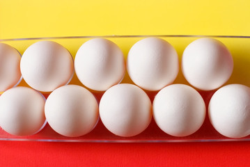 White eggs on color background. Minimalism style for design.