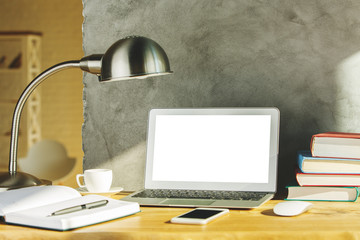 Creative designer workplace with white laptop