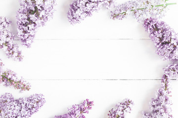 Flowers composition. Spring lilac flowers on white wooden background. Flat lay, top view, copy space