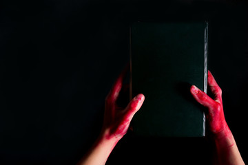 Alchemy book with bloody hand
