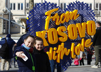 Girls take picture during celebrations of the 10th anniversary of Kosovo's independence in Pristina