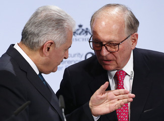 Turkish Prime Minister Yildirim talks with conference chairman Ischinger at the Munich Security Conference in Munich