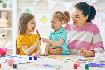 Mother and daughters painting together
