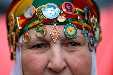 A Pro-Kurd demonstrator attends a protest march demanding the release of the PKK leader Ocalan in Strasbourg