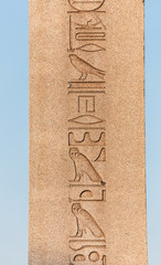 ancient egyptian obelisk with patterns and hieroglyph