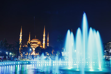 Night view at illuminated fountain and blue mosque in Istanbul