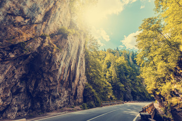 majestic mountain scenery. road in mountains, glowing in sunlight. Romania- Carpathian Mountains. Bicaz Canyon Cheile Bicazului . Beauty in the world. retro vintage style. instagram filter