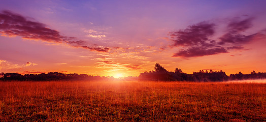 wonderful summer scenery.colorful sunrise over the lake and agriculture fields.