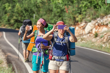 Happy couple taking selfie photo at hike