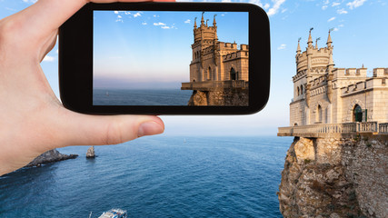 tourist photographs Swallow Nest castle in Crimea