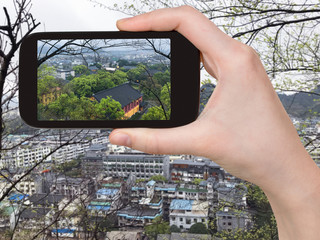 tourist photographs Guilin city in China in spring