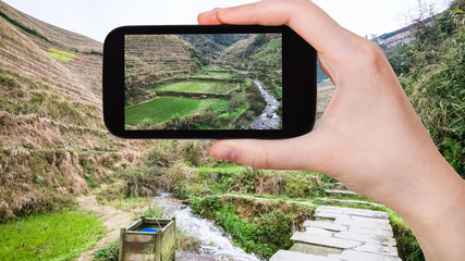 tourist photographs terraced fields in Dazhai