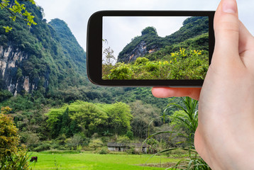 tourist photographs karst mountains in Yangshuo