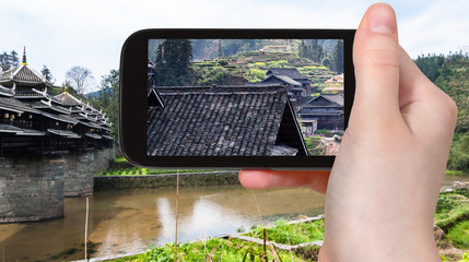tourist photographs village houses in Chengyang
