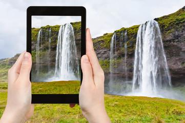 tourist photographs Seljalandsfoss cascade