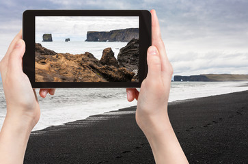 tourist photographs Atlantic ocean volcanic coast