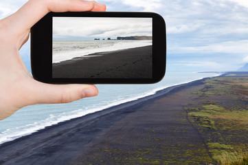 tourist photographs Solheimafjara black sand beach