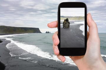 tourist photographs Kirkjufjara black beach