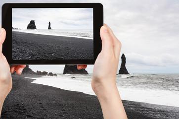 tourist photographs Reynisfjara Beach in Iceland