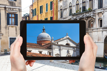 tourist photographs church in Venice city