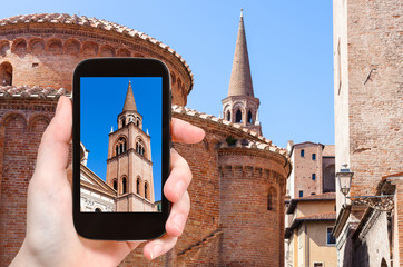 tourist photographs tower and Rotonda in Mantua