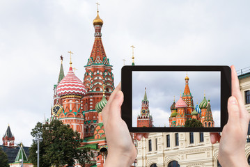tourist photographs St Basil Cathedral in Moscow