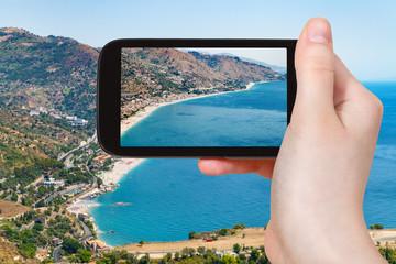 tourist photograph on Ionian Sea coast in Sicily