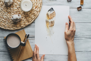 Watercolor painting with paintbrush and mug of coffee