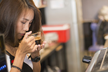 women Barista holding coffee cup