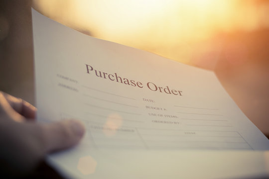Fill in the purchase items in an order form,Close up of purchase order form with pen / selective focus