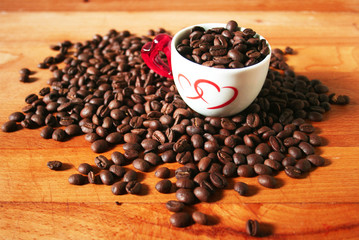 Coffee beans and lovely cup with two hearts