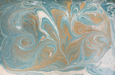 Marble abstract acrylic background. Nature blue marbling artwork texture. Golden glitter.